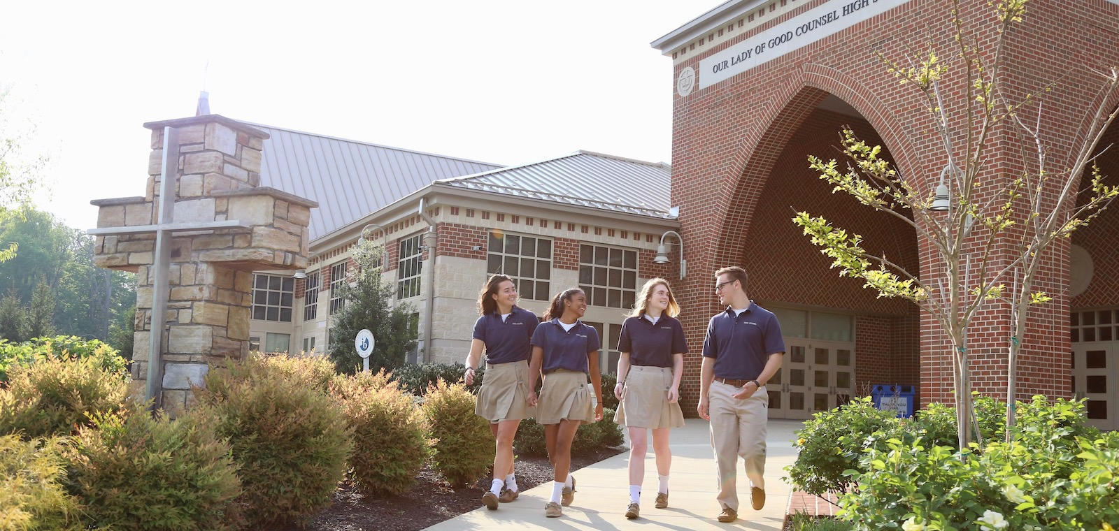four students walking outside of GC campus